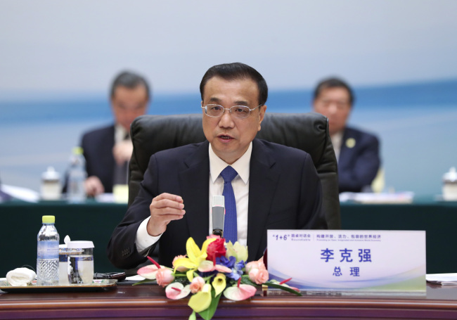 Chinese Premier Li Keqiang holds the '1+6' round table dialogue with heads of major international economic institutions in Beijing on Tuesday, September 12, 2017.[Photo: gov.cn]