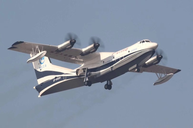 China's first domestic large amphibious aircraft AG600 takes to the skies for maiden flight from the Jinwan Civil Aviation Airport in the city of Zhuhai, Guangdong Province, on Sunday, December 24, 2017. [Photo: China Plus/Li Jin]