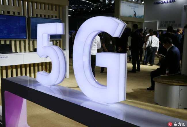 A logo of 5G at a stand during an exhibition in Beijing, China, 27 September 2017. [Photo: IC]