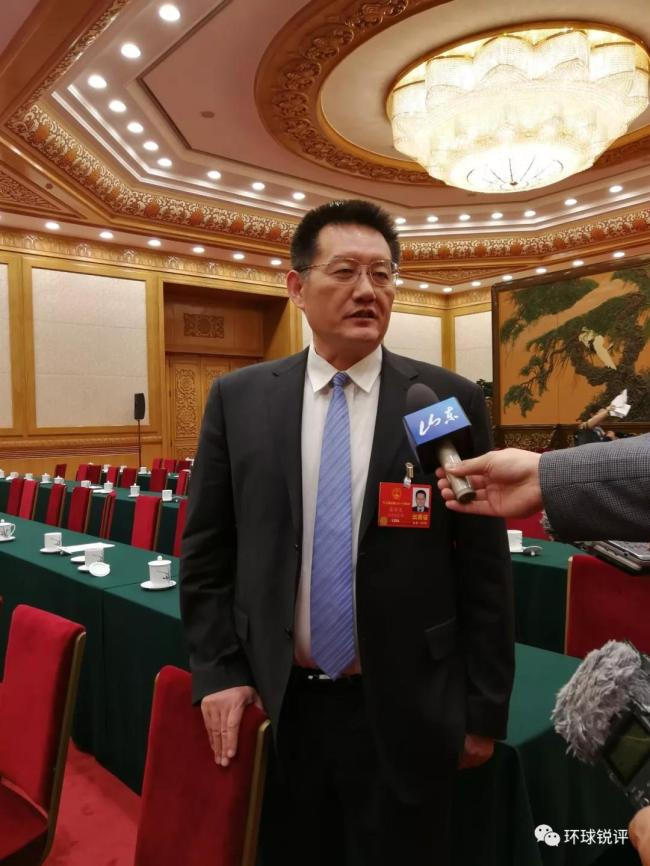 Zhang Xinwen, a deputy from Shandong Province for the 13th National People's Congress (NPC) is interviewed by journalists on March 8, 2018. [Photo: China Plus]