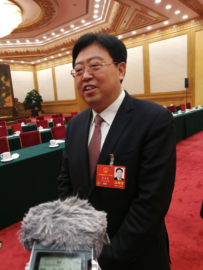 Li Chunkui, a deputy from the municipality of Chongqing for the 13th National People's Congress (NPC) is interviewed by journalists on March 10, 2018. [Photo: China Plus]