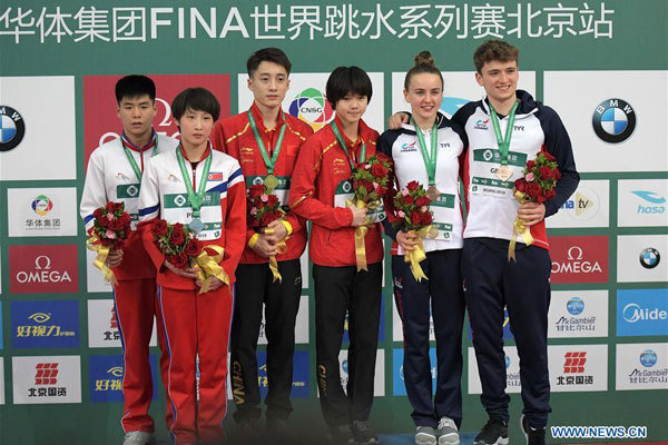 Gold medalists China's Lian Junjie(3rd L)/Lin Shan (3rd R), silver medalists Hyon Il Myong(1st L)/Kim Mi Hwa (2nd L) of the Democratic People's Republic of Korea (DPRK) and bronze medalists Britain's Matthew Lee (1st R)/Lois Toulson pose during the awarding ceremony for the mixed 10m synchronized event at the FINA Diving World Series 2018 in Beijing, capital of China, on March 11, 2018. [Photo: Xinhua/He Changshan]