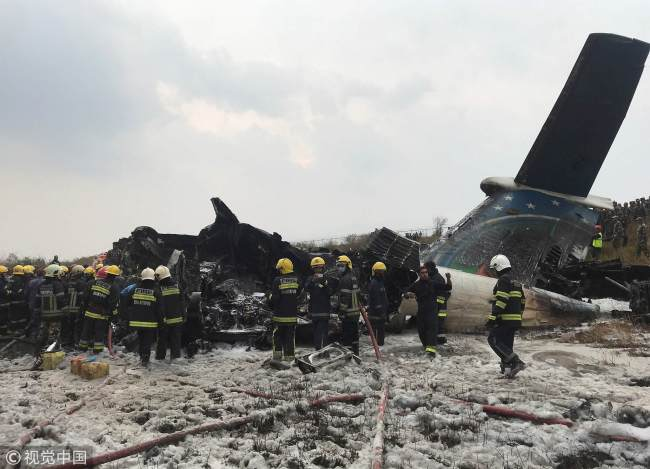 Rescue workers operate around the wreckage of the airplane at Kathmandu airport, Nepal, March 12, 2018. [Photo: VCG]