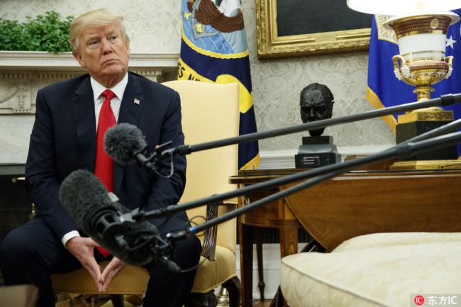 President Donald Trump listens to a question during a meeting with Swedish Prime Minister Stefan Lofven in the Oval Office of the White House, Tuesday, March 6, 2018, in Washington.[Photo: IC]