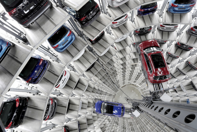 Volkswagen cars are lifted inside a delivery tower of the company in Wolfsburg, Germany, March 14, 2017. [Photo: AP]