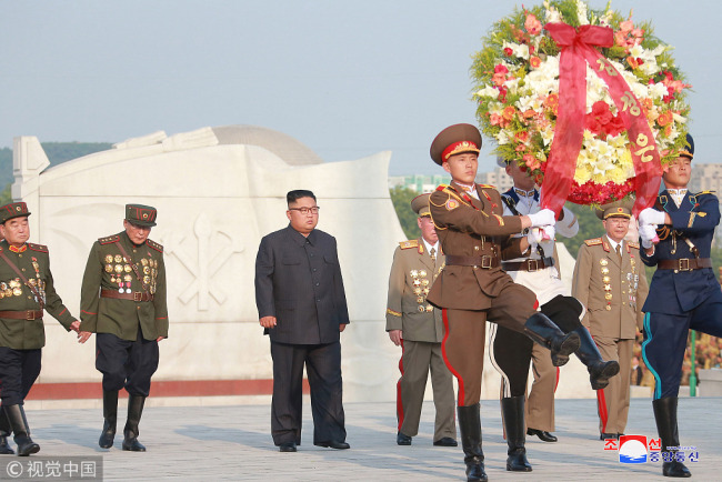 DPRK leader Kim Jong Un visits the Martyrs Cemetery of the Chinese People's Volunteers in Hoechang County, South Phyongan Province in this undated photo released by North Korea's Korean Central News Agency (KCNA) on July 27, 2018. [Photo: VCG]