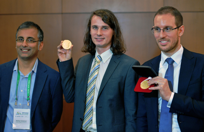 (L to R) Indian Australian mathematician, Akshay Venkatesh, German mathematician Peter Scholze, and Italian mathematician Alessio Figalli, three of four winners of mathematics' prestigious Fields medal, often known as the Nobel prize for math pose at the International Congress of Mathematicians in Rio de Janeiro, Brazil on August 01, 2018. A Kurdish refugee turned Cambridge University professor who was awarded math's most prestigious prize in Rio de Janeiro on Wednesday had the gold medal stolen from him just minutes later, organizers said. [Photo: AFP/Carl de Souza]