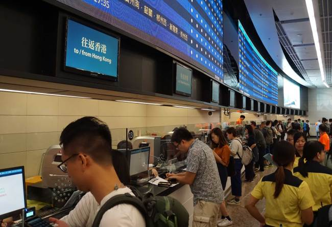 Citizens in front of counters buy tickets for the Guangzhou-Shenzhen-Hong Kong high-speed railway at the West Kowloon railway station in Hong Kong, China, September 10, 2018. [Photo: China Plus/Li Naxin]