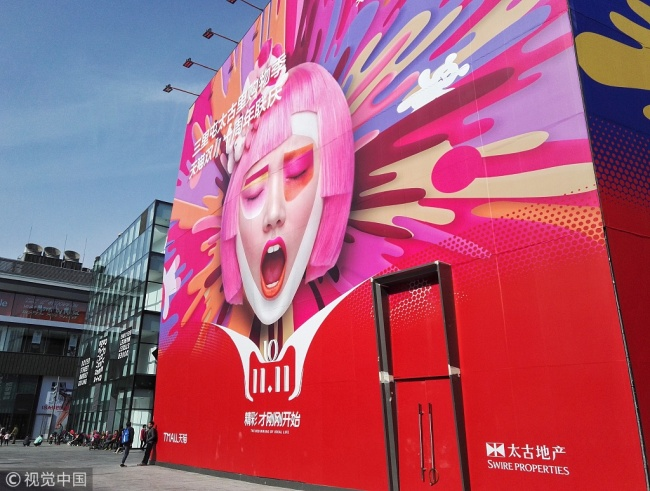 A huge poster of 11.11 in Sanlitun, one of the busiest commercial areas in Beijing. [Photo: VCG]