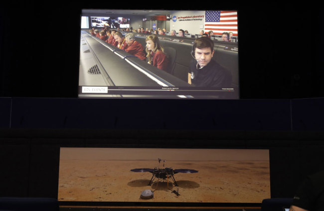 A video feed of the InSight lander mission control room is seen at NASA's Jet Propulsion Laboratory Monday, Nov. 26, 2018, in Pasadena, Calif. The NASA InSight lander arrived successfully on Mars' surface. [Photo: AP/Marcio Jose Sanchez]