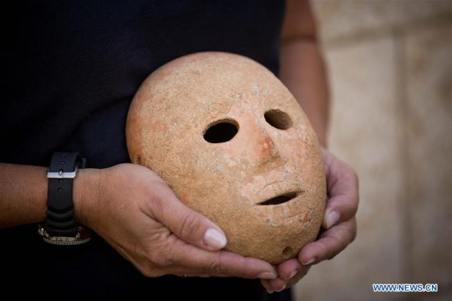Israel discovers 9,000-year-old stone mask in southern West Bank. [Photo: Xinhua]