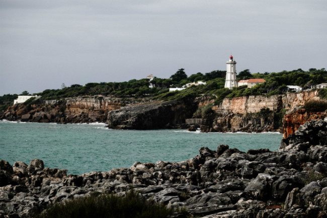 A view of the cliffs, the Atlantic Ocean and a lighthouse at Boca do Inferno in Cascais, Portugal. Cascais is a city and municipality in the Greater Lisbon region, located on the Portuguese Riviera, a major tourist destination and has many international residents. [Photo: IC]