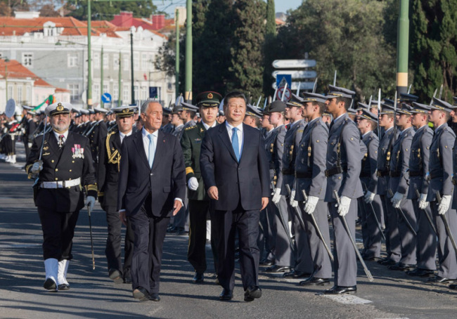 Chinese President Xi Jinping attends a grand welcome ceremony held by Portuguese President Marcelo Rebelo de Sousa in Lisbon, Portugal on Tuesday, December 4, 2018. [Photo: Xinhua]