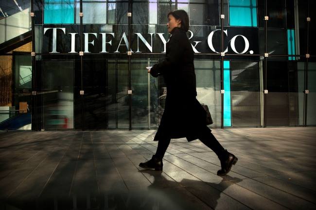 A pedestrian walks past a Tiffany & Co. store at a shopping mall in Beijing, November 29,2018.[Photo:IC]