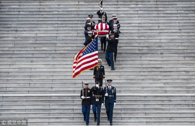 The remains of President George H.W. Bush are transported from the U.S. Capitol to the National Cathedral Wednesday December 5, 2018. [Photo: VCG]