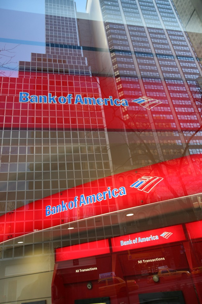 In this Jan. 25, 2009 file photo, a Bank of America branch office is shown in New York. A federal judge said Monday, Feb. 22, 2010, he would reluctantly approve an amended $150 million settlement between the Securities and Exchange Commission and Bank of America to end civil charges accusing the bank of misleading shareholders when it acquired Merrill Lynch. [Photo:AP]