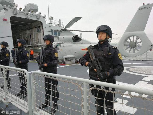 Naval soldiers board a vessel that is setting sail from Zhanjiang, south China's Guangdong Province, on Sunday, December 9, 2018. [Photo: VCG]
