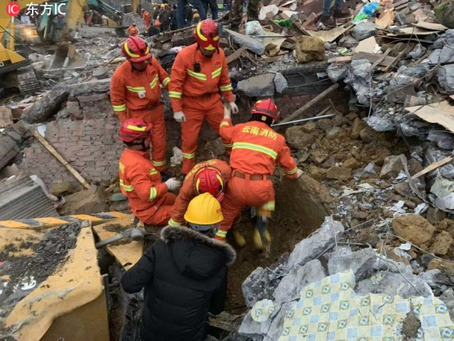 Eight people have been pulled out of the debris of a landslide that toppled three houses in southwest China's Sichuan Province on December 9, 2018. [Photo: IC]