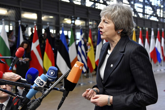 British Prime Minister Theresa May speaks with the media as she arrives for an EU summit in Brussels, Thursday, Dec. 13, 2018. [Photo: AP/Geert Vanden Wijngaert]