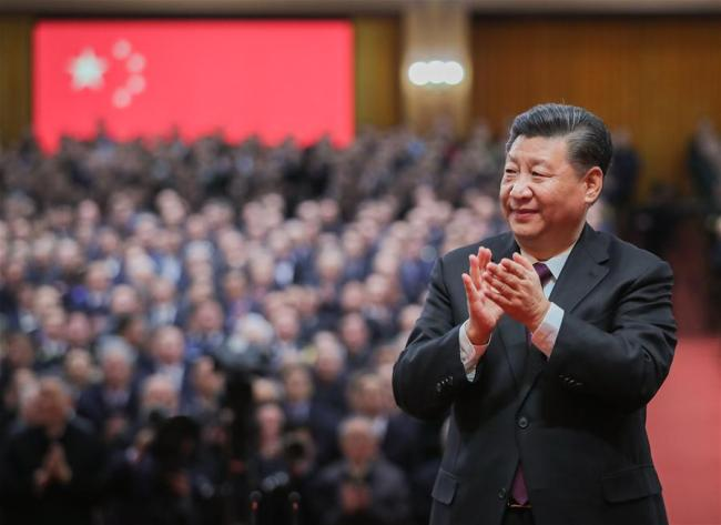 Chinese President Xi Jinping, also general secretary of the Communist Party of China (CPC) Central Committee and chairman of the Central Military Commission, applauds for the personnel awarded with medals during a grand gathering to celebrate the 40th anniversary of China's reform and opening-up at the Great Hall of the People in Beijing, capital of China, Dec. 18, 2018. Xi made an important speech at the gathering. [Photo: Xinhua/Xie Huanchi]