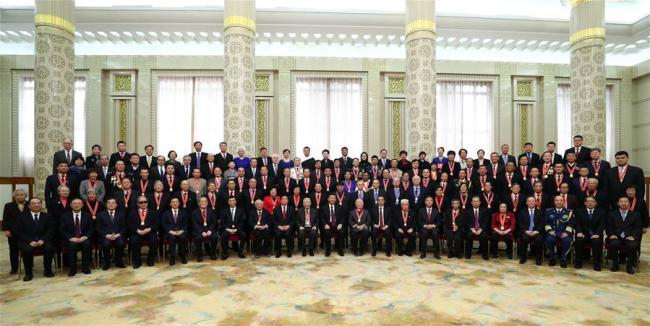 Chinese President Xi Jinping, also general secretary of the Communist Party of China (CPC) Central Committee and chairman of the Central Military Commission, and other Chinese leaders pose for group photos with the personnel awarded for their outstanding contributions to the reform and opening-up and their relatives after a grand gathering to celebrate the 40th anniversary of China's reform and opening-up at the Great Hall of the People in Beijing, capital of China, Dec. 18, 2018. Xi made an important speech at the gathering. [Photo: Xinhua/Xie Huanchi]