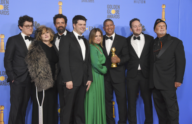 """The cast and crew of """"Spider-Man: Into the Spider-Verse"""" pose in the press room with the award for best motion picture, animated at the 76th annual Golden Globe Awards at the Beverly Hilton Hotel on Sunday, Jan. 6, 2019, in Beverly Hills, Calif. [Photo: Invision/AP/Jordan Strauss]"""