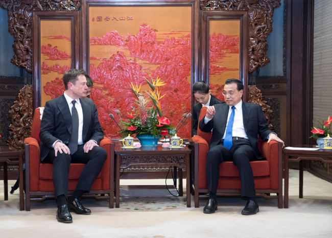 Chinese Premier Li Keqiang meets with Tesla CEO Elon Musk on January 9, 2019. [Photo: gov.cn]