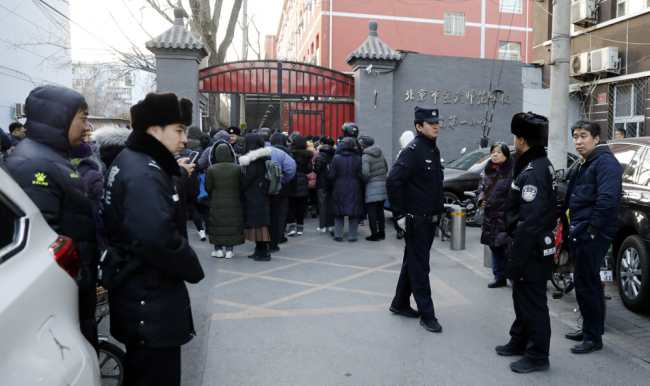 olicemen stand guard outside Xuanwu Normal Experimental Affiliated Number One Primary School, after 20 primary school pupils were wounded in an attack at the school in Beijing on January 8, 2019. [Photo: IC]