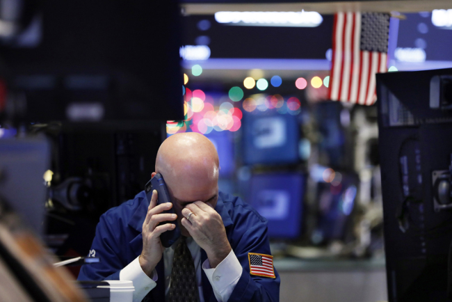 A trader talks on his phone on the floor of the New York Stock Exchange, Wednesday, Jan. 2, 2019. [File photo: AP/Richard Drew]