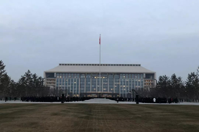 A flag raising ceremony is held at dawn on January 11, 2019 in front of the new office building of Beijing Municipal Government in the new sub-center in Beijing's Tongzhou district. [Photo: CCTV]