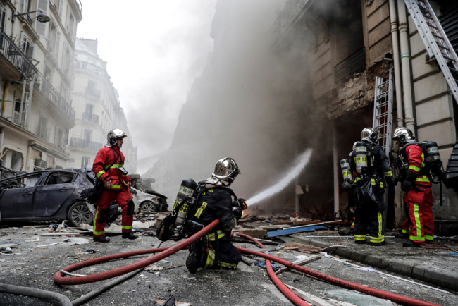 Firefighters extinguish a fire after the explosion of a bakery on the corner of the streets Saint-Cecile and Rue de Trevise in central Paris on January 12, 2019. [Photo: AFP/Thomas Samson]