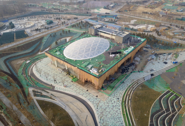 An Aerial photo taken by a drone on January 19, 2019 shows the Plant Pavilion in 2019 International Horticultural Exhibition site in Yanqing District, Beijing. [Photo: Xinhua]