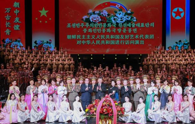 Xi Jinping, general secretary of the Communist Party of China (CPC) Central Committee and Chinese president, and his wife Peng Liyuan pose for a group photo with artists of an art troupe from the Democratic People's Republic of Korea (DPRK) after watching their performance in Beijing, capital of China, Jan. 27, 2019. Xi and Peng met with the art troupe led by Ri Su Yong, a member of the Political Bureau of the Workers' Party of Korea (WPK) Central Committee, vice-chairman of the WPK Central Committee and director of the party's International Department, before its performance.[Photo:Xinhua]