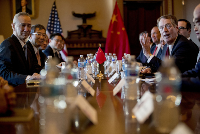 Chinese Vice Premier Liu He, left, and US Trade Representative Robert Lighthizer, right, sit across the table as they begin US-China Trade Talks in the Diplomatic Room of the Eisenhower Executive Office Building on the White House Complex, Wednesday, Jan. 30, 2019, in Washington. [Photo: AP]