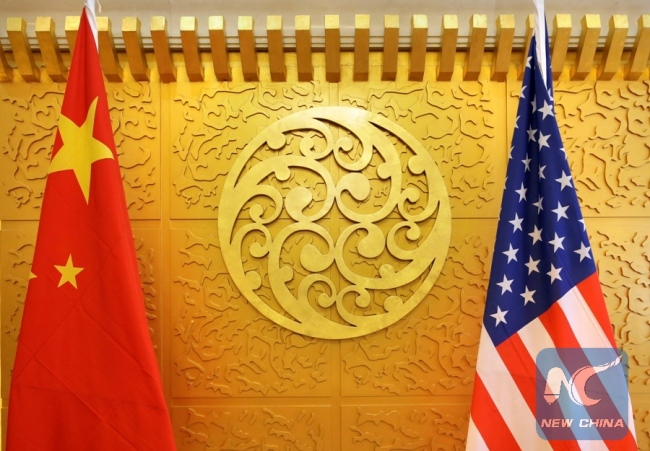 Chinese and U.S. flags are set up for a meeting during a visit by U.S. Secretary of Transportation Elaine Chao at China's Ministry of Transport in Beijing, China April 27, 2018.[File Photo:Xinhua/REUTERS]