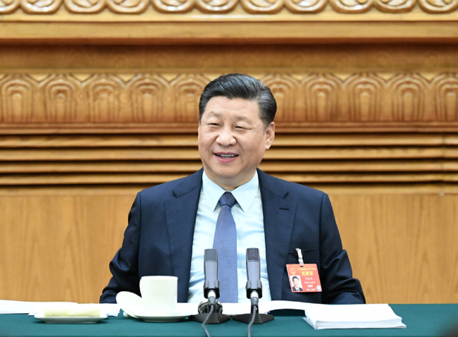 President Xi Jinping attends a panel discussion with his fellow deputies from Henan Province at the second session of the 13th National People''s Congress in Beijing, March 8, 2019. [Photo: Xinhua]