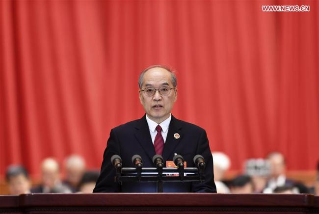 Zhang Jun, procurator-general of the Supreme People's Procuratorate (SPP), delivers a report on the SPP's work at the third plenary meeting of the second session of the 13th National People's Congress (NPC) at the Great Hall of the People in Beijing, March 12, 2019. [Photo: Xinhua/Yan Yan]