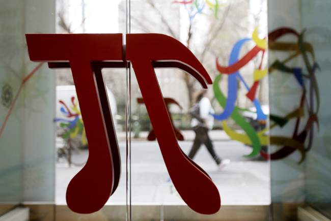 A door handle in the shape of pi is seen at the new National Museum of Mathematics in New York, Dec. 17, 2012. [File photo: IC]