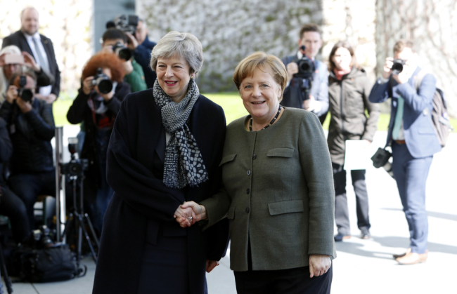 German Chancellor Angela Merkel (R) shakes hands with British Prime Minister Theresa May as she arrives at the Chancellery in Berlin on April 9, 2019. [Photo: AFP]