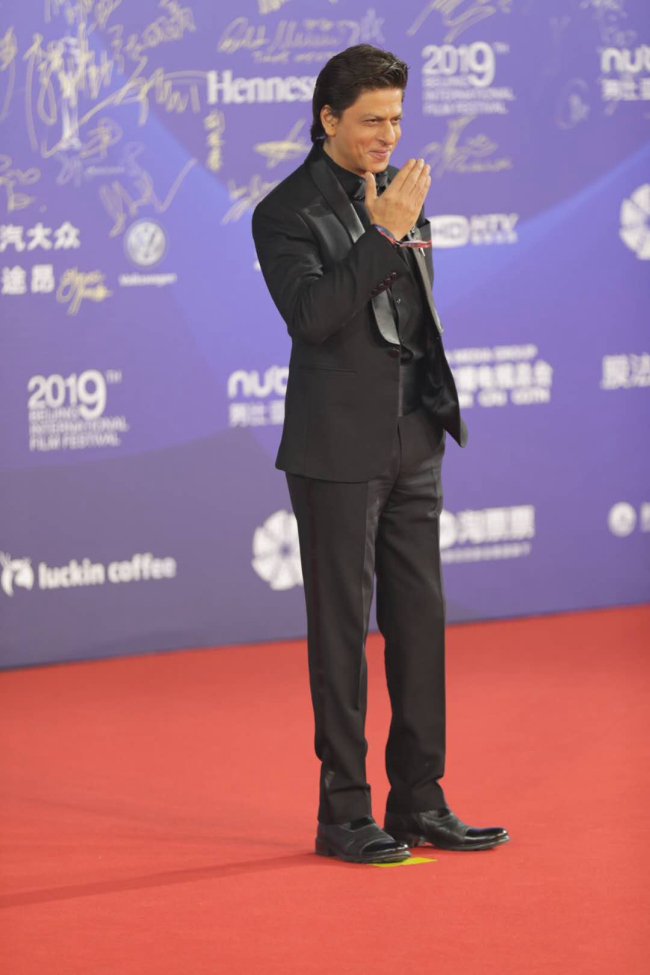 """Bollywood's """"King Khan"""" Shah Rukh Khan poses for photo at the red carpet, at the closing ceremony for the 9th Beijing International Film Festival, on April 20, 2019, in Beijing. [Photo: CGTN]"""