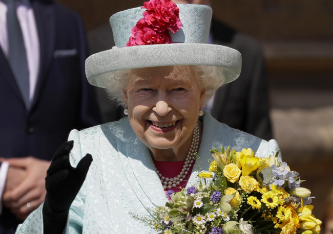 Britain's Queen Elizabeth II waves to the public as she leaves after attending the Easter Mattins Service at St. George's Chapel, at Windsor Castle in England Sunday, April 21, 2019. [Photo: AP]