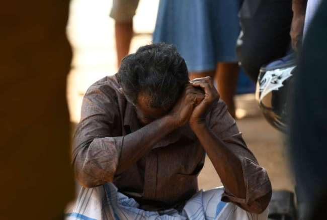 A relative of a Sri Lankan victim of an explosion at a church weeps outside a hospital in Batticaloa in eastern Sri Lanka on April 21, 2019. A series of eight devastating bomb blasts ripped through high-end hotels and churches holding Easter services in Sri Lanka on April 21, killing nearly 160 people, including dozens of foreigners. [Photo: AFP]