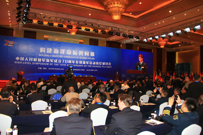 The photo shows the representatives of Chinese and other countries' navies attend the seminar on the theme of Building a Maritime Community of Shared Future in Qingdao on Apr 24, 2019. [Photo provided to China Plus]
