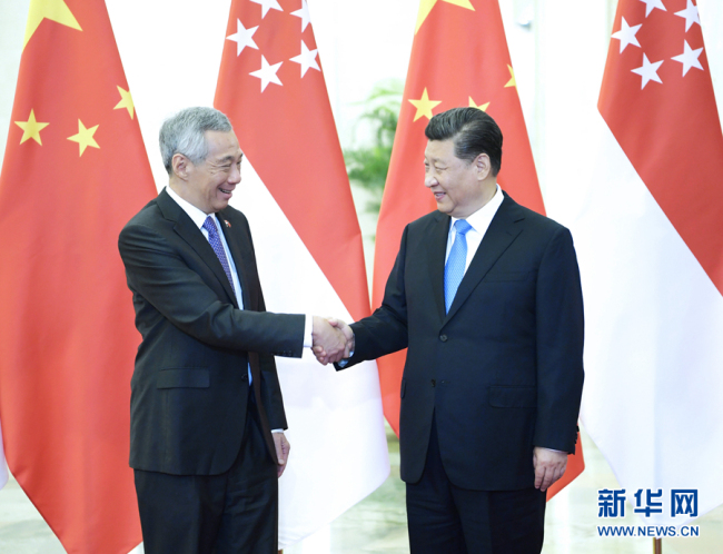 Chinese President Xi Jinping meets with Singapore's Prime Minister Lee Hsien Loong at the Great Hall of the People in Beijing, capital of China, April 29, 2019.[Photo: Xinhua/Li Xueren]