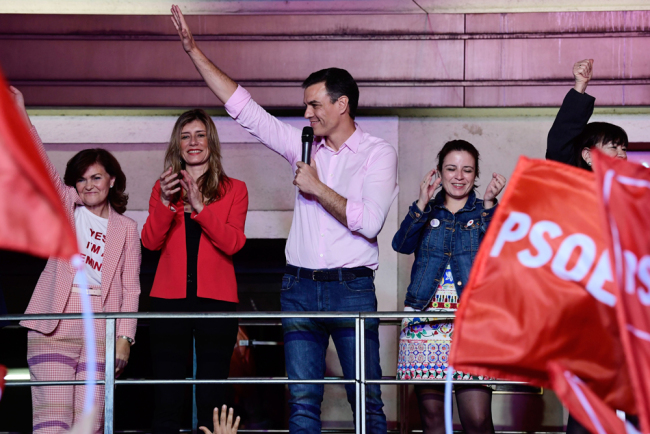 Spanish Prime Minister Pedro and Socialist Party (PSOE) candidate for prime minister Pedro Sanchez (C) waves beside vice-secretary general Adriana Lastra (R) and her wife Begona Gomez (2L) during an election night rally in Madrid after Spain held general elections on April 28, 2019. [Photo: AFP]