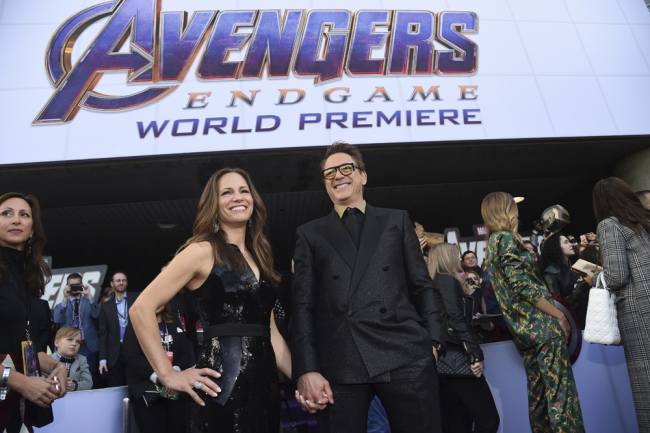 "Susan Downey, left, and Robert Downey Jr. arrive at the premiere of ""Avengers: Endgame"" at the Los Angeles Convention Center on Monday, April 22, 2019. [File Photo: AP]"