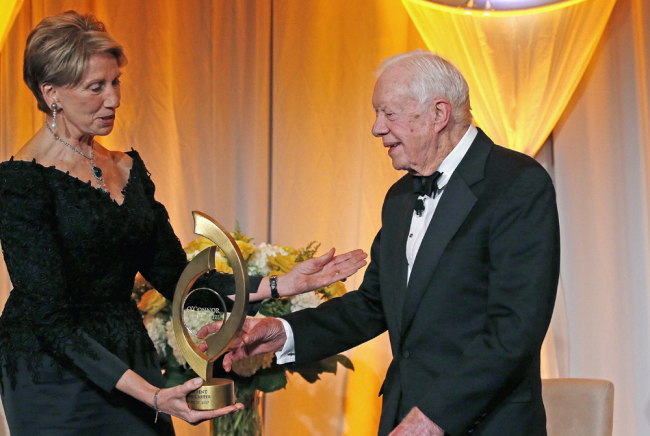 In this Jan. 27, 2017, file photo, former President Jimmy Carter, right, accepts the O'Connor Justice Prize from former U.S. Ambassador to Finland Barbara Barrett, left, at The Sandra Day O'Connor College of Law at Arizona State University Justice Prize Dinner in Phoenix. President Donald Trump has nominated Barrett to be the next secretary of the Air Force. [File photo: AP/Ross D. Franklin]