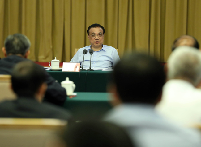 Premier Li underscores tax, fee cuts, better financial
