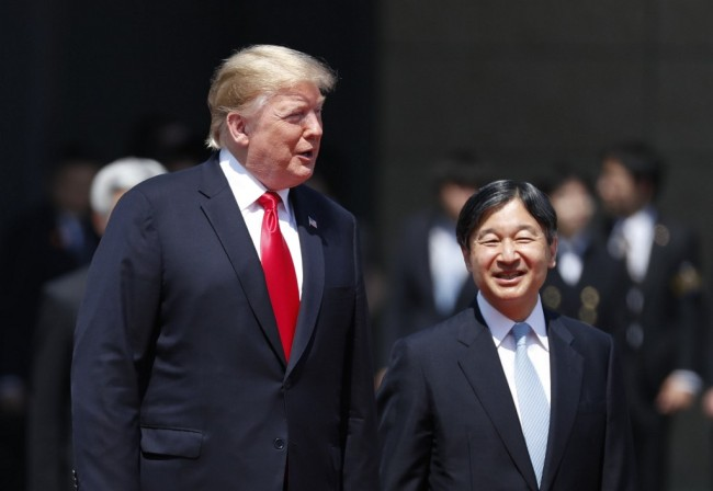 US President Donald Trump is escorted by Japan's Emperor Naruhito during a welcome ceremony at the Imperial Palace in Tokyo on May 27, 2019. [Photo: AFP]