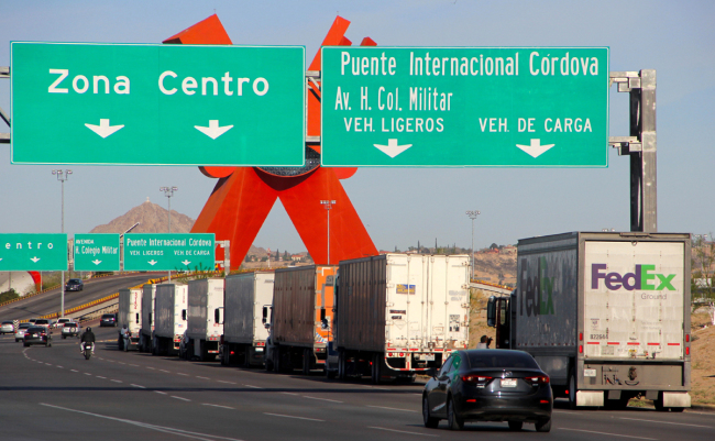 Cargo trucks lineup to cross to the United States near the US-Mexico border at the Cordova-Americas International Bridge in Ciudad Juarez, Chihuahua state, Mexico, on April 4, 2019. US President Donald Trump is expected to visit a section of the border fence in Calexico during his tour to California on Friday.[Photo: AFP]